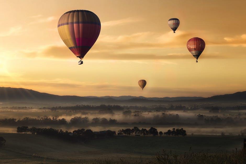 hot-air-balloon-valley-sky-99551.jpeg
